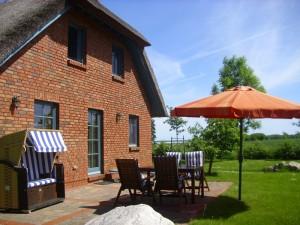 """Reetdachhaus """"Innisfree"""" in idyllischer Lage mit Blick auf das nahegelegene Haff"""